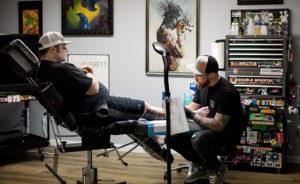 Alex Everett working on a tattoo.